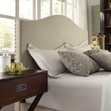 bedroom white cotton sheets with beige wingback headboard and