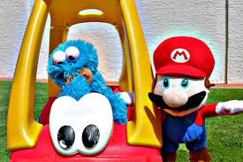 cookie monster and super mario play at backyard playground and