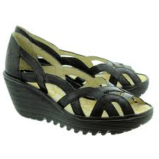 fly london ladies yadi peep wedge sandals in black in black