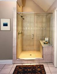 clear glass block as divider walk in shower with cream marble wall