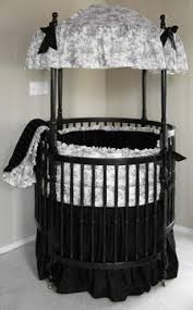 round bassinet w wheels converts into a crib toddler bed plus