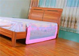 toddler bedroom with wooden sleigh bed and bed rail functional