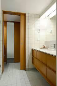 Help With Barn Door Color Type For Mcm Home - Mid century bathroom vanity light