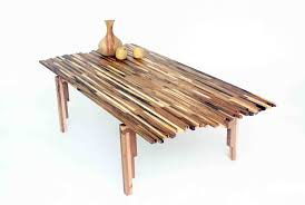 beautiful wildfire table made from multi tone scraps of acacia