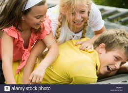 young boy wrestling with brother stock photo royalty free image
