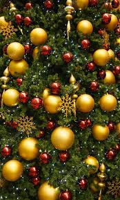 gold and ornaments on green tree stock photo