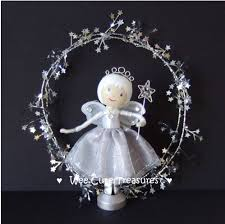 idea for a magical silver fairy with wand clothes peg doll