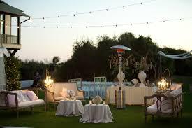 beachside garden outdoor wedding seating area burlap chandeliers