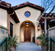 spanish house colors entry mediterranean with round window
