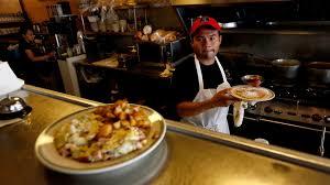 workers celebrate l a u0027s new 12 minimum wage businesses brace