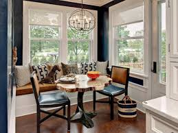 dining room dark wooden flooring with round wood table and padded