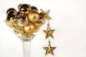 martini glass of golden ornaments stock photo image