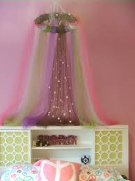 designed and made a tulle canopy for a little girls bedroom