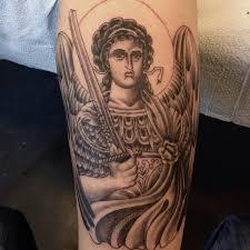 25 protecting saint michael tattoos history u0026 meanings tattoo