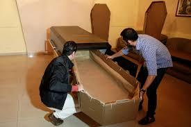 cardboard coffin economic crisis cardboard coffins set trend as wooden