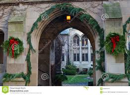 Medieval Decorations by Christmas Decorations On Old Sandstone Building Stock Photo
