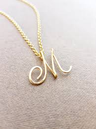 gold necklace with letter images Cursive gold letter alphabet initial m necklace jpg