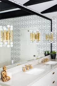 293 best bathrooms images on pinterest bathroom ideas room and white and black bathroom features a white ceiling accented with glossy black moldings placed above walls clad in noir greek key wallpaper lined with a white