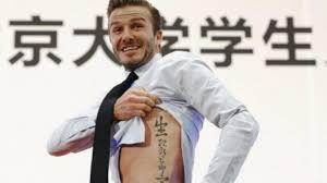 beckham tattoo in hong kong david beckham s chinese tattoo inspires amusing photoshop fakes
