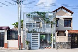 a21 studio intertwines steel and vines to create a low cost home