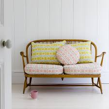 Wooden Sofa Pink And Yellow Sofa Cushions On A Retro Wooden Sofa St Judes