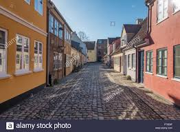 old homes in cobbled streets in odense the city of hans christian
