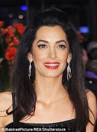 is amal clooney hair one length amal clooney beams as she poses in photo from student days daily