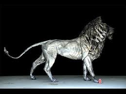 awesome lion sculpture made of scrap metal