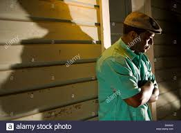 porch at night african american man in cap standing on porch at night stock photo