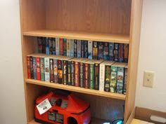 Homemade Bookshelves by A Row Of Books On The Cardboard Bookshelf Riser So You Can See How