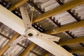 Roof Fan by Old Ceiling Fan Hanging Under An Asbestos Roof Stock Photo
