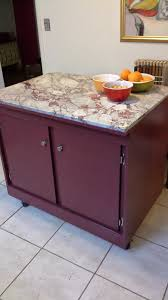 spectacular marble top rolling kitchen island in maroon red paint