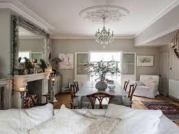 white kitchen grey flooring dining room open floor plan open plan