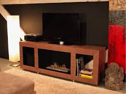flat screen smokeless fireplace heater around white brick wall