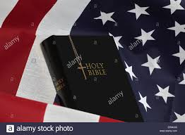 Flag With Bible Bible And Gold Cross On United States Of American Flag Stock Photo