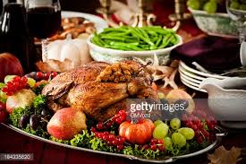thanksgiving dinner with stuffed turkey and side dishes stock