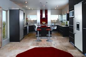 high end kitchen design with black cabinetry also island also