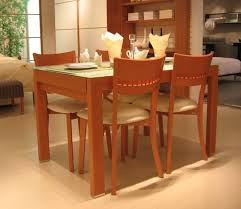 Simple Dining Table And Chairs Dining Room Simple Dining Space Alongside Soft Brown Doff Wood