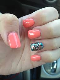 coral and teal nails with glitter accent nail they nailed it