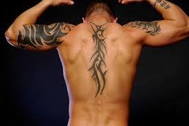 ithaka tribal back tattoos idea for