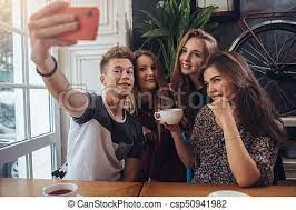 cute teenagers group of cute teenagers taking selfie with cellphone while