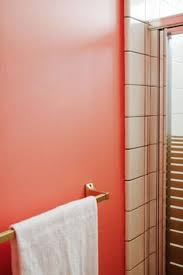 retro details in a tiny rose pink bathroom paint color