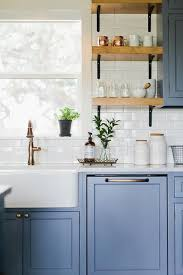 white shaker kitchen cabinets with white subway tile backsplash blue shaker kitchen cabinets with white subway tiles