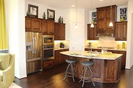 model home with knotty alder cabinet doors large island and dark