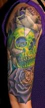 skull and roses half sleeve by phil young tattoos