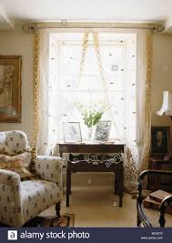 Patterned Armchair Cream Patterned Armchair In Small Cottage Living Room With Antique