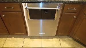 kitchenaid dishwasher with window and lighted interior in action