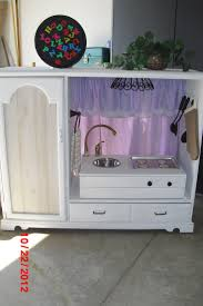 30 best the charmed nest s furniture creations images on pinterest entertainment center turned into a play kitchen