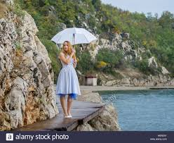 Beautiful Outdoors by Attractive Beautiful Blonde Woman Waiting Wait On Seaside Near Sea