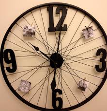 Weird Clock by Diy Bicycle Wheel Clock Spray Paint Wheel And Numbers From Hobby